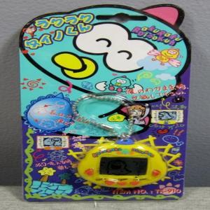 http://www.ebay.com/itm/NEW-Sealed-Yellow-RakuRaku-Dinokun-Dinkie-Dino-Electroni